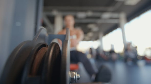 Cover Image for Pulling Down Cable Of Crossover Machine In The Gym
