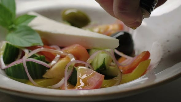 Thumbnail for Greek Salad  is Dressed with Olive Oil