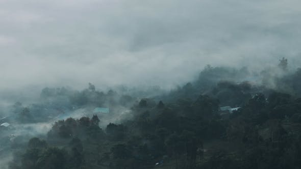 Thumbnail for Fog Moving Above Village On Mountain