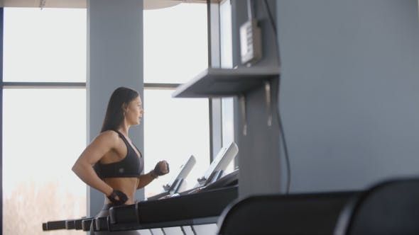 Thumbnail for Young Beautifull Woman Running On A Treadmill Cardio Training