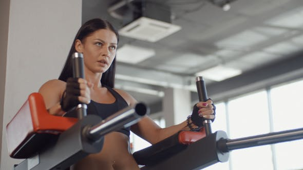Thumbnail for Young Brunette Girl Doing Press-ups At The Gym