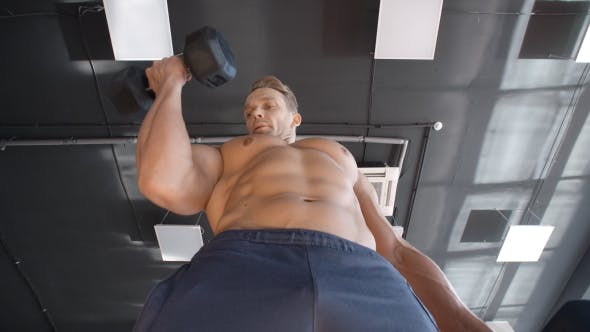 Thumbnail for Young Muscular Man Lifting Heavy Dumbbells In The Gym