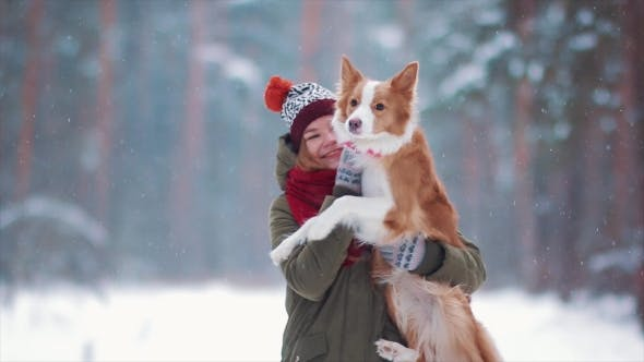 Thumbnail for Young Happy Woman Hugging Cute Dog in Winter