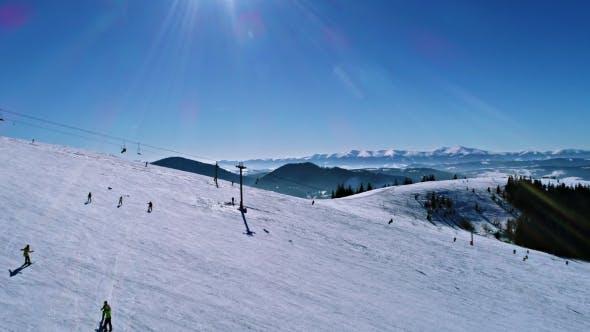 Thumbnail for Aerial - Ski Lift at Ski Resort in Sunny Carpatian Mountains