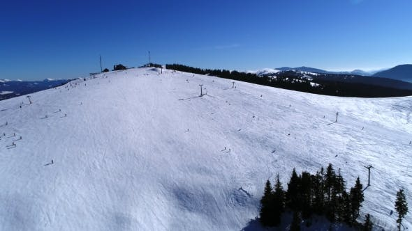 Cover Image for Aerial - Ski Lift at Ski Resort in Sunny Carpatian Mountains