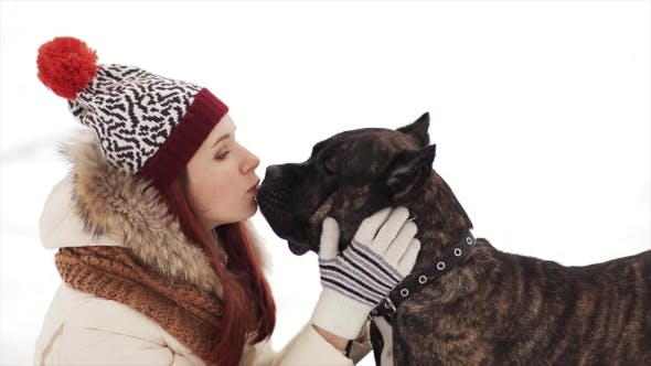 Thumbnail for Happy Girl Kissing Her Dog in Winter