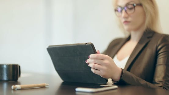 Thumbnail for Attractive Young Woman Using Digital Tablet at Home