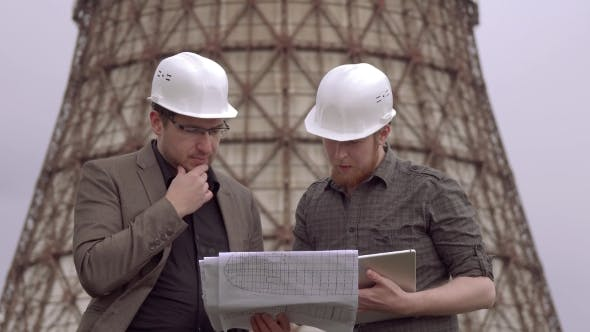 Thumbnail for Two Businessmen in the Construction Helmets on the Background of the Nuclear Power Plant