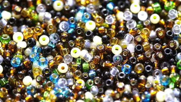 Thumbnail for Multicolored Beads Rotate In The Sun Rays