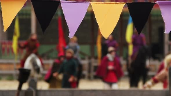 Cover Image for Defocused People in Medieval Clothes Performing Traditional Dance, Singing Songs