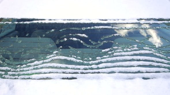 Thumbnail for Snow Is Melting Down on the Rear Window of the Car