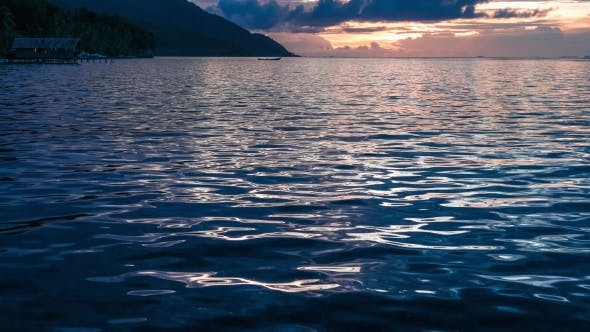 Thumbnail for Sunset Over Kri and Monsuar, Calm Waves Moving on the Ocean Surface, West Papua, Raja Ampat