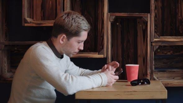 Thumbnail for Man Using Smart Phone