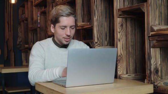 Cover Image for Man Using Laptop