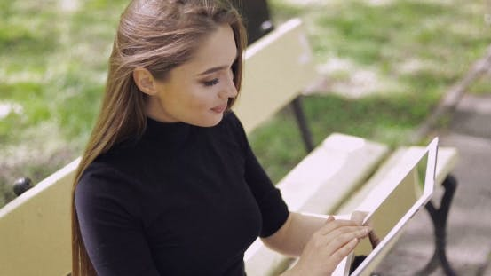 Cover Image for Beautiful Girl Browsing Tablet