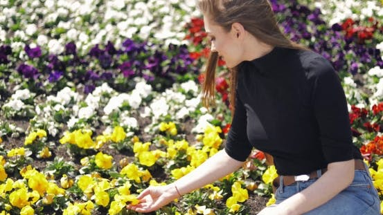 Thumbnail for Female Posing with Flowers on Ground