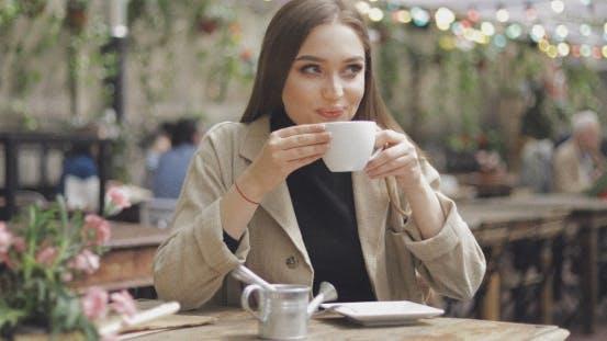 Thumbnail for Lovely Female Enjoying Coffee