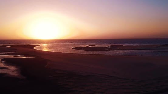 Thumbnail for Drone Flying Over Sea and Orange Sunset, India