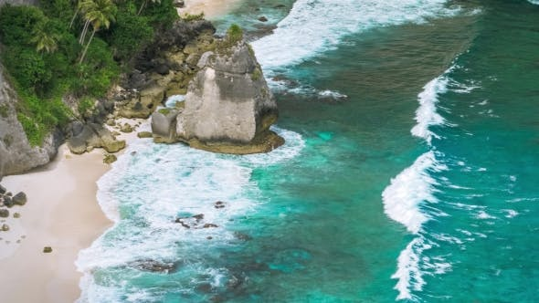Thumbnail for Rock in the Ocean with Beautiful Palms Behind at Atuh Beach on Nusa Penida Island, Indonesia