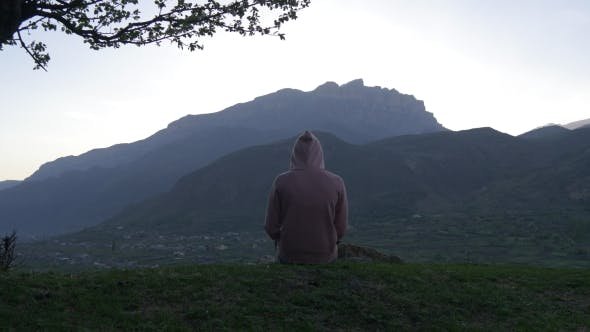 Thumbnail for Figure in a Jacket with a Hood in the Mountains