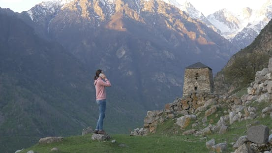 Thumbnail for Woman on the Background of Ruins and Tower