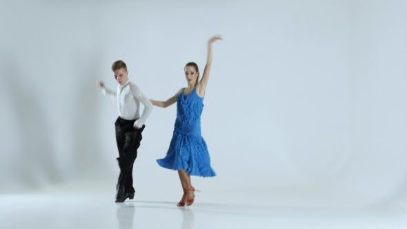 Thumbnail for Couple of Graceful Dancers Perform Latino on White Background, Shadow