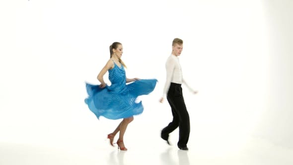 Thumbnail for Tango Dancing Couple of Professional Elegant Dancers on White Background