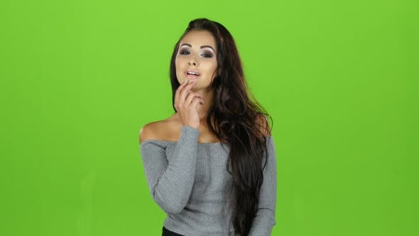 Thumbnail for Sexy Model Brunette Woman Sends Air Kisses, Green Screen Background