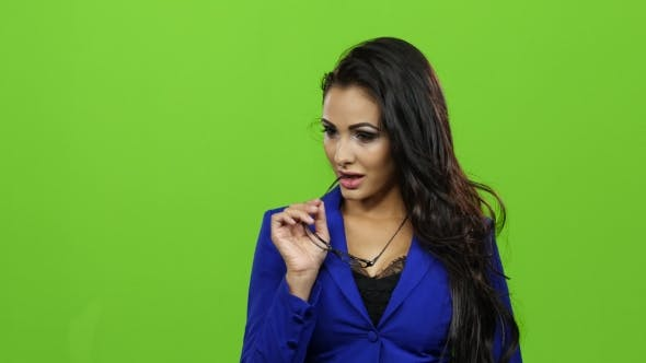 Thumbnail for Seductive Brunette Woman in Glasses Posing on Green Screen Background