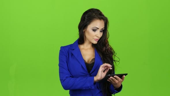 Thumbnail for Brunette Woman with Smile Works on Tablet, Green Screen Background