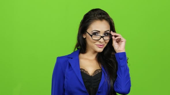 Thumbnail for Sexy Brunette Woman with Glasses Posing on Camera, Green Screen