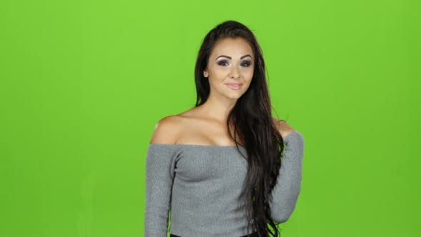 Thumbnail for Brunette Woman Giving Out Air Kisses, Emotions. Green Screen Background