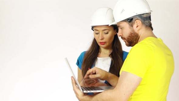 Thumbnail for Construction Engineers or Architects Discuss Project and Use the Laptop