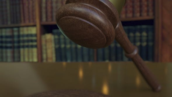 Thumbnail for Judge's Gavel Falling and Hitting the Block with SUE Inscription