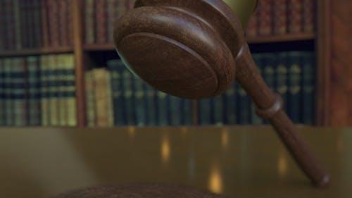 Judge's Gavel Falling and Hitting the Block with LEGISLATION Inscription