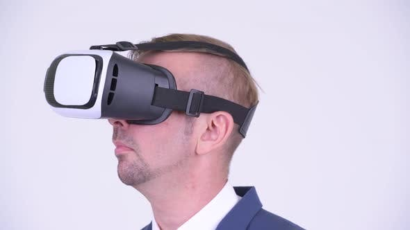 Cover Image for Head Shot of Blonde Businessman Using Virtual Reality Headset
