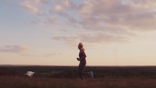 Young Woman Jogging in a Scenic Spot at Sunset