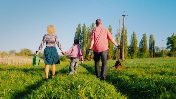Cover Image for A Family of Farmers with a Small Son Go Together To Plant a Tree