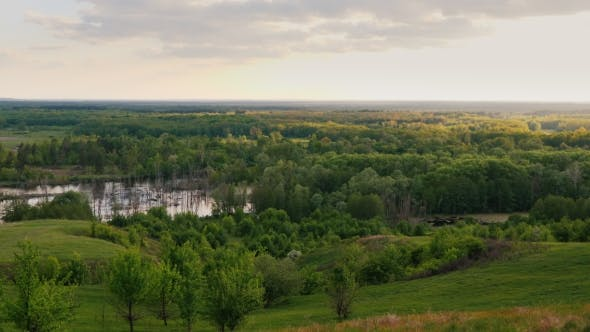 Cover Image for Picturesque Green Valley. After the Flood, the Water Spilled.  10 Bit Video