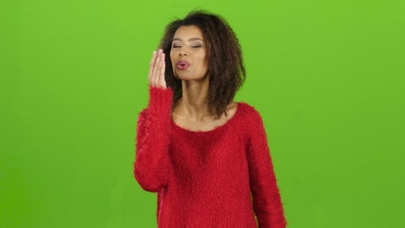 Thumbnail for Sexy Model Mulatto Woman Sends Air Kisses, Green Screen Background