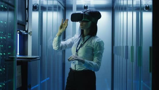 Thumbnail for Woman in VR Glasses Working in Data Center