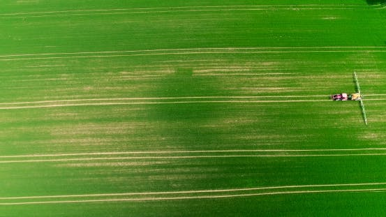 Thumbnail for Farmer Fertylizing Field