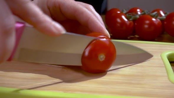 Thumbnail for Knife Cuts Tomato on Wooden Board