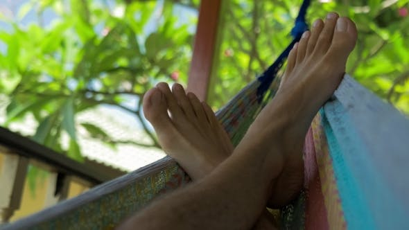 Thumbnail for Swinging Bare Man Feets in a Hammock on Terrace. Vacation on Koh Tao Tanote Bay, Thailand