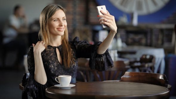 Cover Image for Smiling Girl Taking Selfie