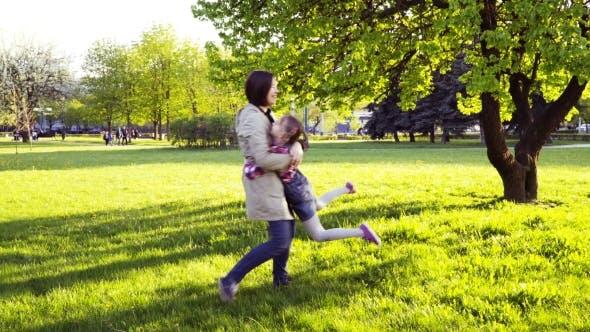 Thumbnail for Family Hug in Park