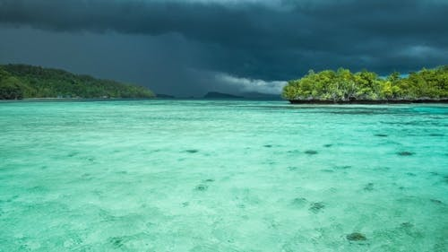 Beautiful Blue Lagoon with Pure Clear Water Shortly Before Thunderstorm Begining, Gam Island, West