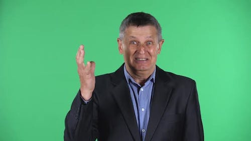 Portrait of Aged Man Showing Gesture Come Here, Isolated Over Green Background.