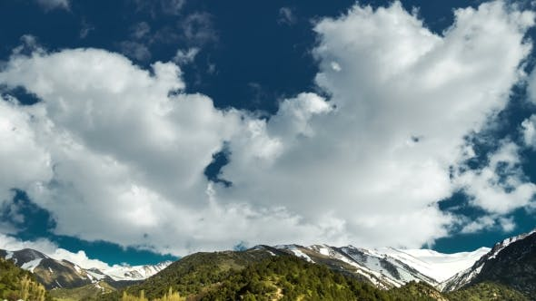 Thumbnail for Clouds Drifting Along Top of Rocky Mountain Peaks