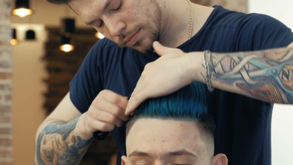Thumbnail for Master Cuts Hair and Beard of Men in the Barbershop, Hairdresser Makes Hairstyle for a Young Man.